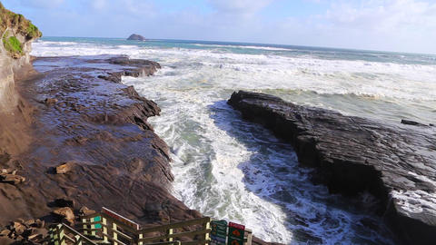 shot of the rock formations at the Murawai ocean s Stock Video Footage