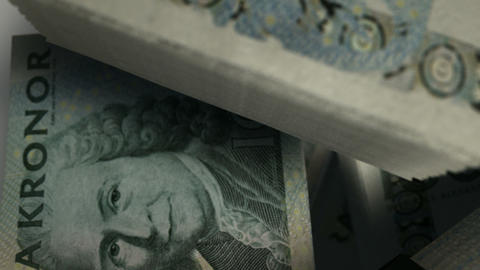 swedish kronor notes scattered pile pan above Animation