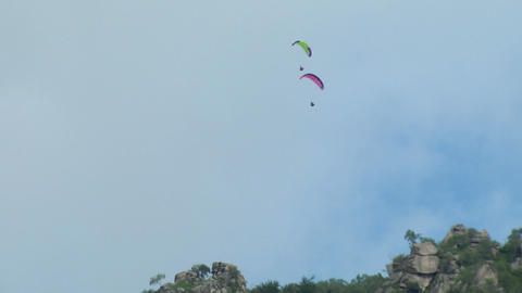 Acrobatic Paragliding Synchro Green Magenta 31 stock footage