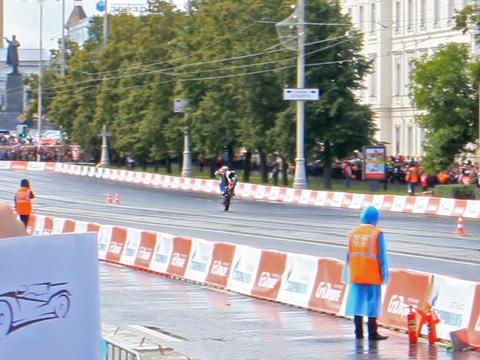 Biker rides on the rear wheel on wet asphalt. G-Dr Stock Video Footage