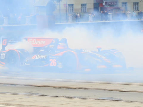 Vehicle team G-Drive Racing smokes tires. G-Drive  Footage