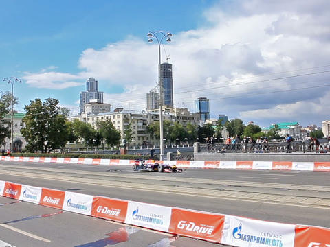 F1 car twists on a city street. G-Drive Show. 640x Footage