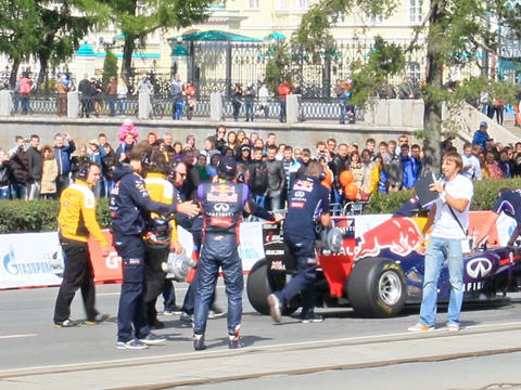 Formula 1 cars are pushing through the city. G-Dri Stock Video Footage