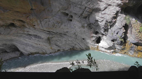 birds eye dolly shot of liwu river and pothole in Stock Video Footage