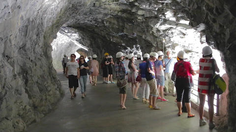 tourists in the swallow grotto cave tunnel Footage