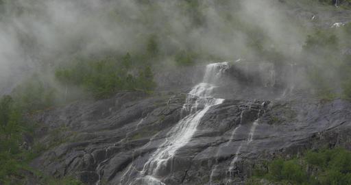 4K, Norway, Waterfall embedded in fog Stock Video Footage