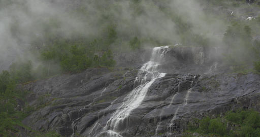 4K, Norway, Waterfall embedded in fog Filmmaterial
