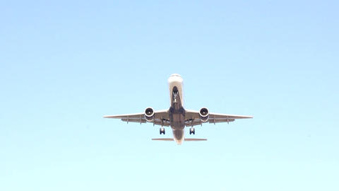 Airplane Is Landing and flying over head Stock Video Footage