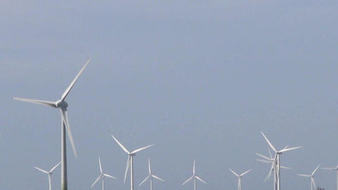 wind power farm producing energy in the environmen Stock Video Footage