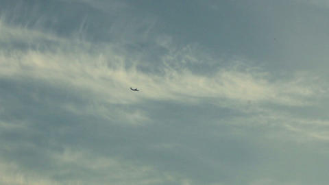 Flying Plane On A Dark Blue Sky Background stock footage