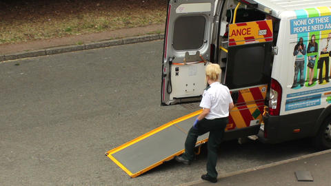 Female Paramedic Enters Ambulance stock footage