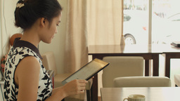 Young Woman Playing With A Tablet in a Cafe Footage
