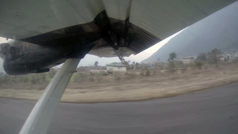 2.7K. Take off on the plane from Lukla, Nepal. Air Footage