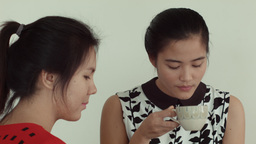 Young Asian Women Enjoying Tea and Laughs Together Footage