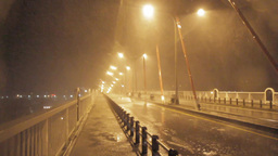Heavy rain and strong wind on a bridge during a ty Footage