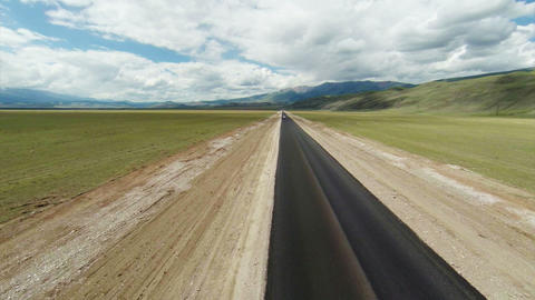 Stock Footage Flight Over the Highway to Mountains Stock Video Footage