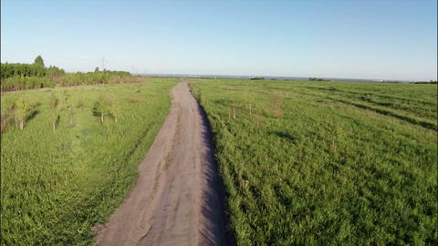Aerial Stock Footage Dirt road in Grassland Footage
