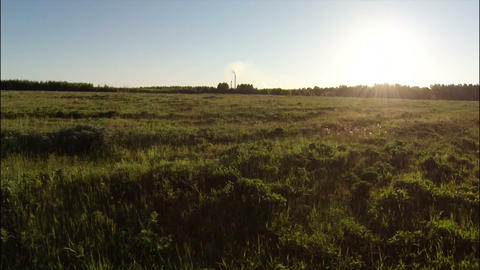 Aerial Stock Footage Flight to Sunset in Grassland Footage