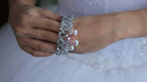 The bride wears a bracelet Footage