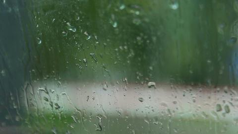 Raindrops on car window Footage