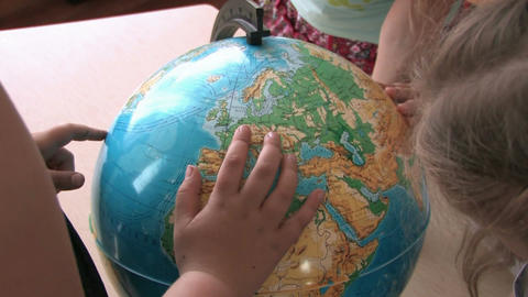 Children playing with globe Footage