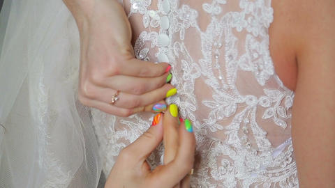 Buttoning on the bride 's dress Stock Video Footage