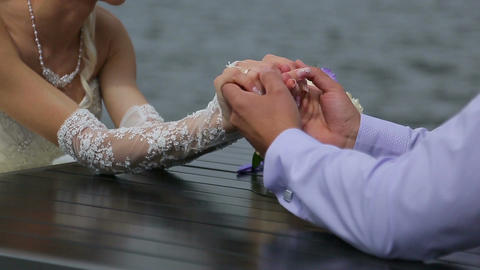 Hands of bride and groom Stock Video Footage