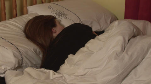 Stock Footage of a Woman in Bed Footage