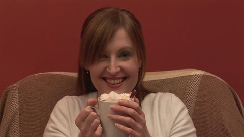 Stock Footage of a woman on a couch Drinking Coffe Footage