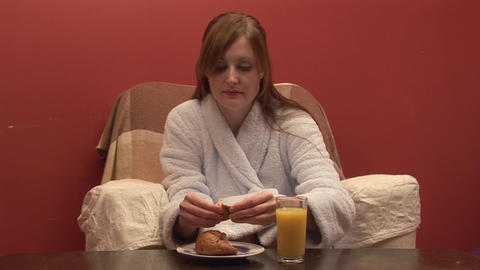 Stock Footage of a Woman Eating Breakfast Footage