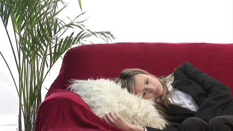 Woman relaxing on sofa Stock Video Footage