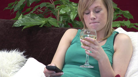 Woman relaxing with a Glass of Wine Footage