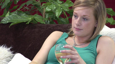 Woman on Sofa relaxing with a Glass of Wine Footage