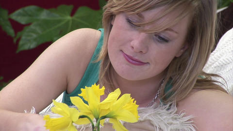 Woman Smelling a Flower Footage