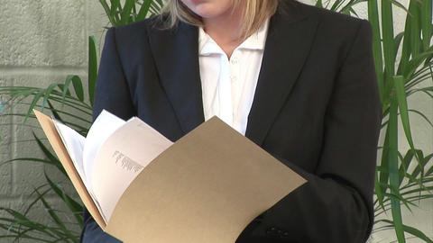 Business woman examining a Document Footage