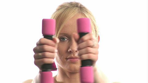 Young woman exercising with dumbells Footage