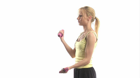 Young woman exercising with dumbells Stock Video Footage