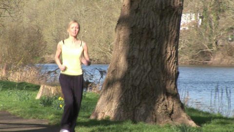 A young Woman Jogging Footage