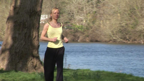 A young Woman Jogging Stock Video Footage