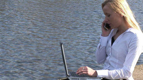 Young attractive blonde woman on laptop outdoors Stock Video Footage