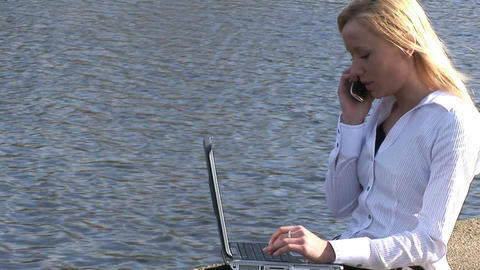 Young attractive blonde woman on laptop outdoors Footage