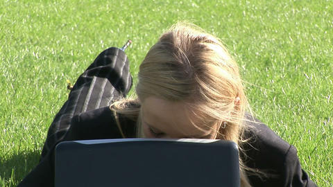 Young attractive blond woman on laptop outdoors Footage