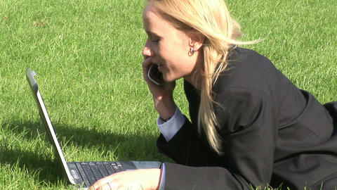 Woman lying on grass using laptop computer Stock Video Footage