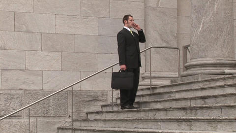 Man On Steps Of Building stock footage