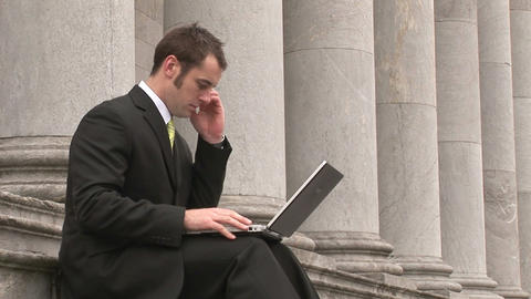 Business man Outdoors Using Laptop Footage