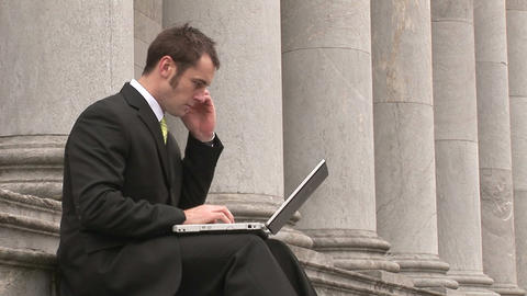 Business man Outdoors Using Laptop Stock Video Footage