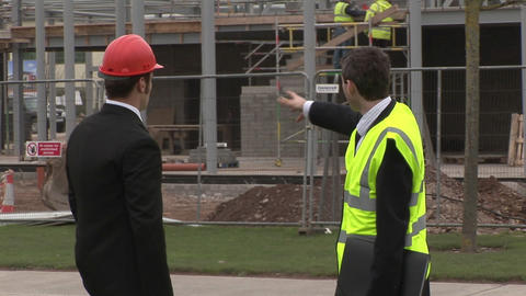 Two engineers in discussion at a Construction Site Footage