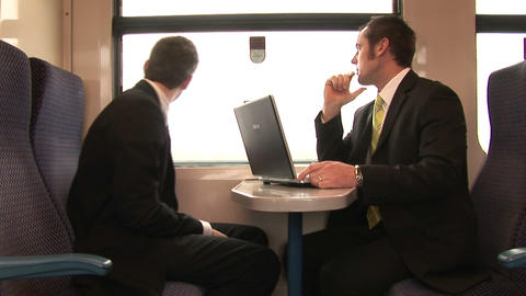 Businessman Working on a Train Footage