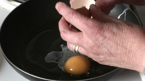 Cooking an Egg Stock Video Footage