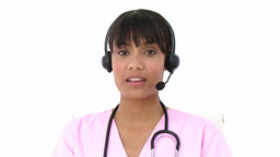 Young nurse using headset Stock Video Footage
